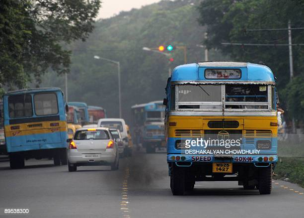 Black fumes smoke from a bus in Kolkata on July 31 2009 Asof August 1 the state government plans to execute a High Court order banning vehicles 15...