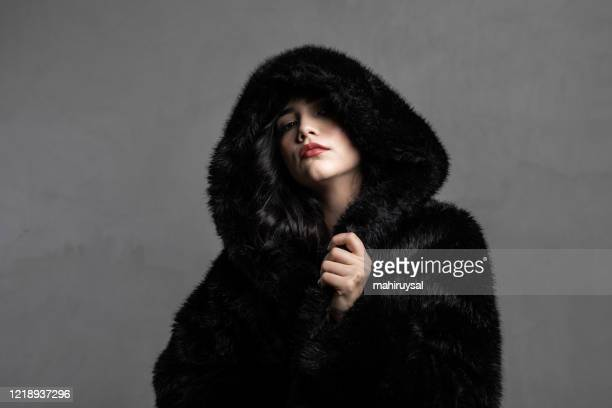 black fur hood - fur coat stock pictures, royalty-free photos & images