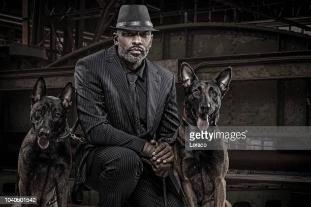 black gangster man with guard dogs - guard dog stock photos and pictures