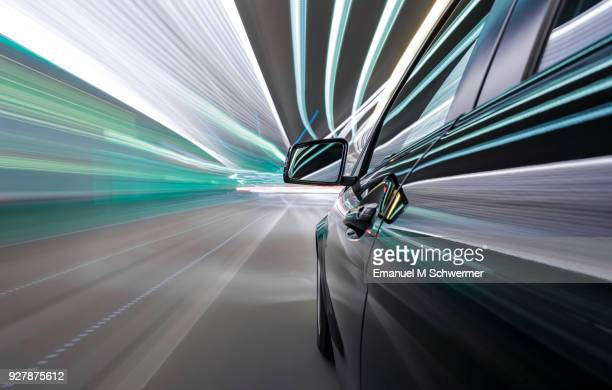black german car drives through a modern tunnel - transporte fotografías e imágenes de stock