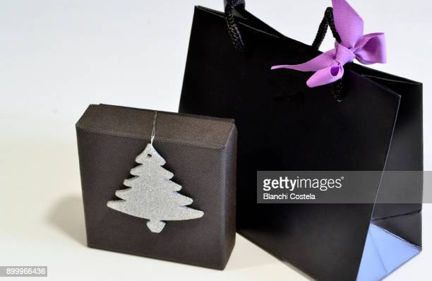 Black gift bag and box with a lilac bow