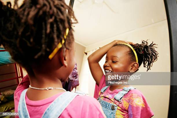 black girl admiring herself in mirror - girl in mirror stock photos and pictures
