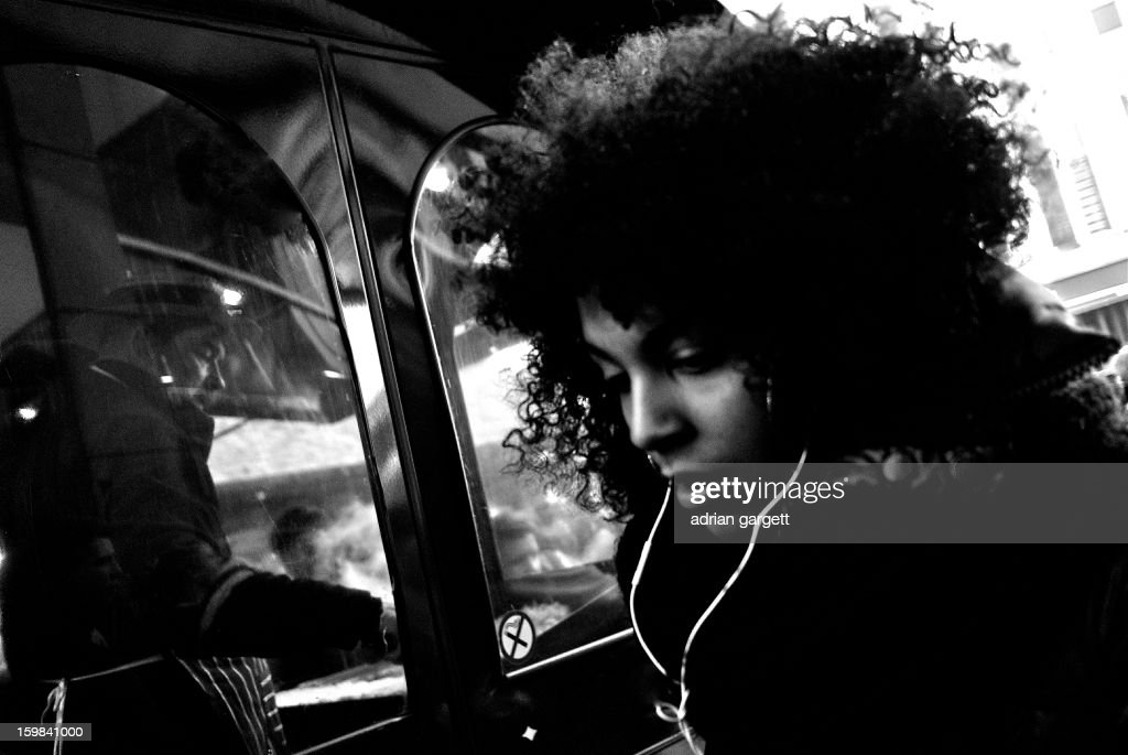 CONTENT] Black girl in a hurry. Busy city. Birmingham. Girl hurries past a fast-food stand. Lost in music or lost in thought.