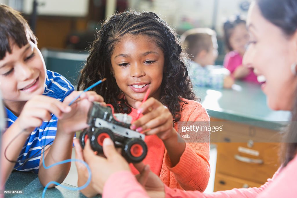 Black girl in science class learning robotics : Stock Photo