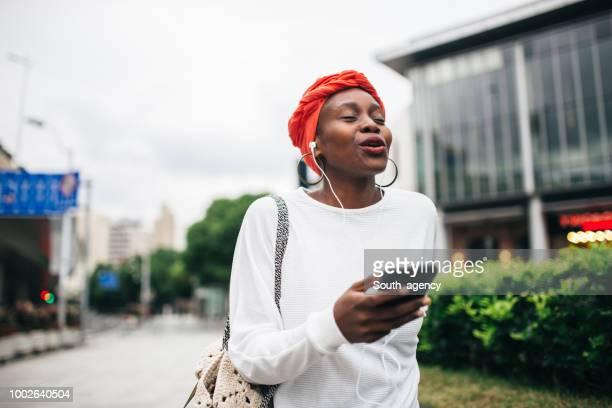 Black girl listening music
