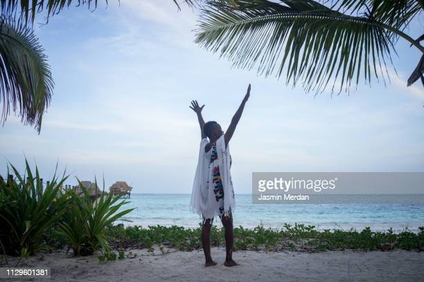 black girl on tropical sea pier - native african girls stock pictures, royalty-free photos & images