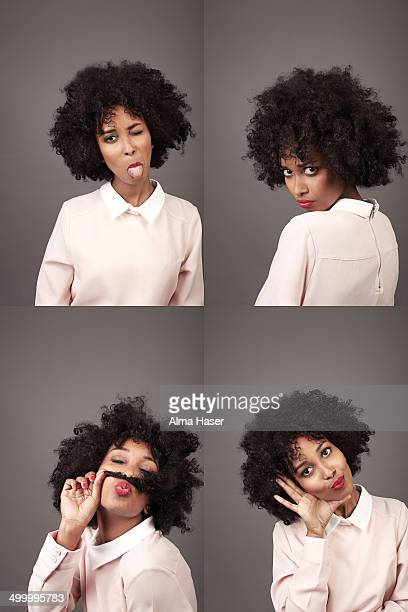 black girl with afro posing in a photo booth