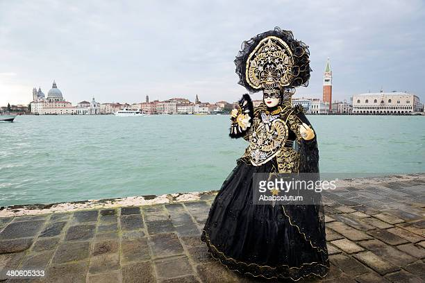 black golden mask, venice carnival at san giorgio, italy, europe - black mask disguise stock pictures, royalty-free photos & images