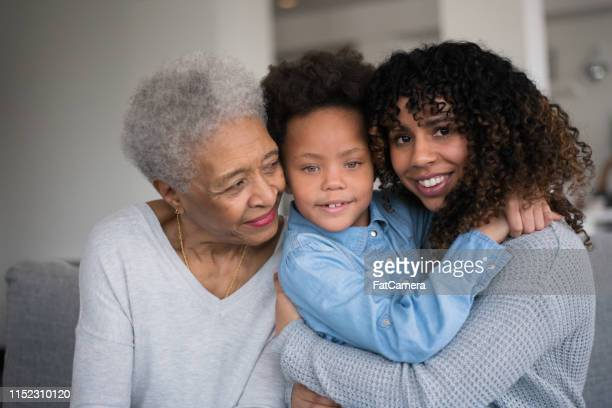 black grandma spending time with daughter and granddaughter - fat granny stock pictures, royalty-free photos & images