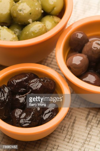 black green and red olives in terracotta dishes high-res stock photo