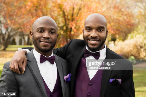 Black groom and best man posing at wedding