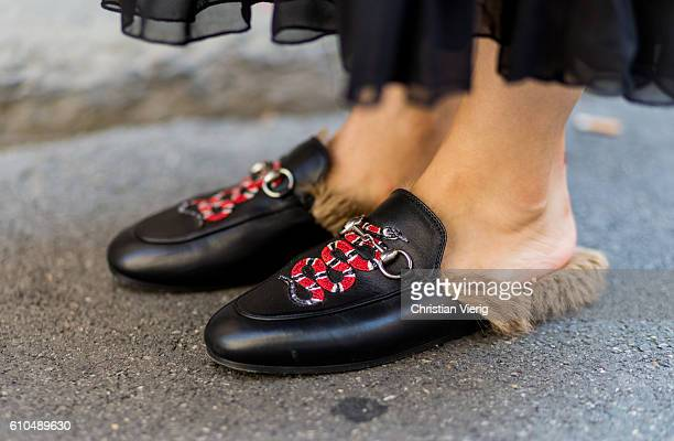 Black Gucci loafers outside during Milan Fashion Week Spring/Summer 2017 on September 25 2016 in Milan Italy