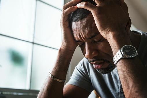 Black guy stressing and headache 938919394
