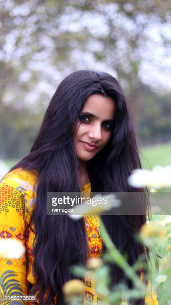 black hair women in flowers - black hair stock pictures, royalty-free photos & images