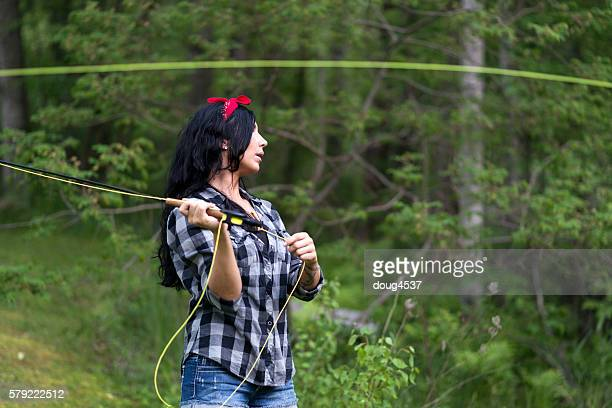 Black Haired Woman Casting a Fly Rod