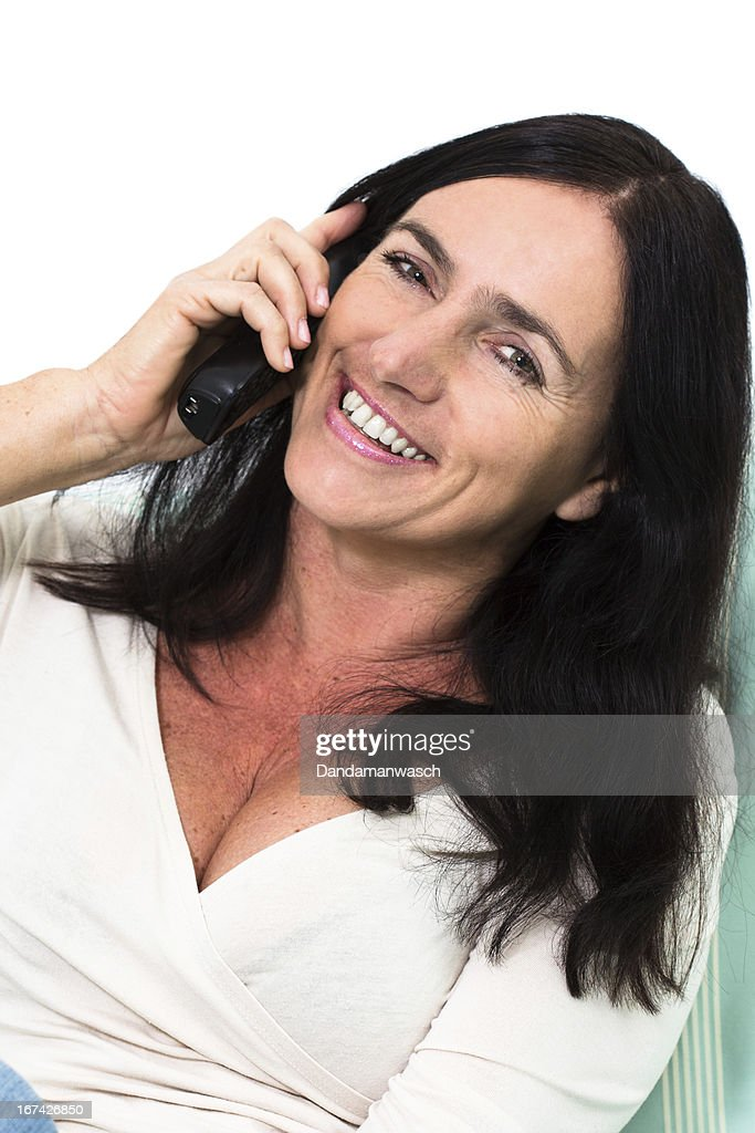 Black Haired Woman Talking On Phone : Stock Photo