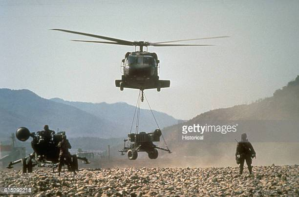 Black Hawk brings in an M167 towed Vulcan Air Defense System as the crew of a second VADS prepares their weapon for action during the joint South...