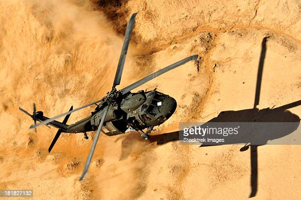 A UH-60 Black Hawk helicopter comes in for a dust landing.