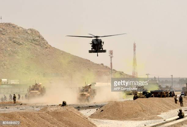 A US black hawk helicopter flies over the site of a Taliban suicide attack in Kandahar on August 2 2017 A Taliban suicide bomber on August 2 rammed a...