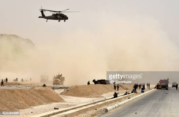 Black hawk helicopter flies over the site of a Taliban suicide attack in Kandahar on August 2, 2017. A Taliban suicide bomber on August 2 rammed a...