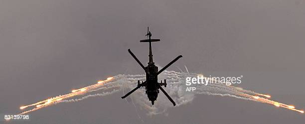 A Black Hawk helicopter performs in the Colombian airshow in Cali department Valle del Cauca Colombia on October 5 during the celebration of the 75th...