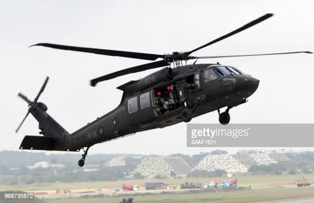 Black Hawk helicopter takes part in during the Han Kuang drill at the Ching Chuan Kang air force base in Taichung central Taiwan on June 7 2018...