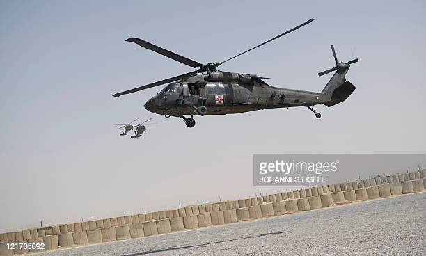 Black Hawk medevac helicopter of 159th Brigade Task Force Thunder lands at FOB Pasab in Kandahar province on August 22 2011 Afghanistan is gripped in...