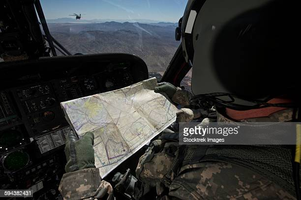 UH-60 Black Hawk pilot reading a map while in flight to New Mexico.