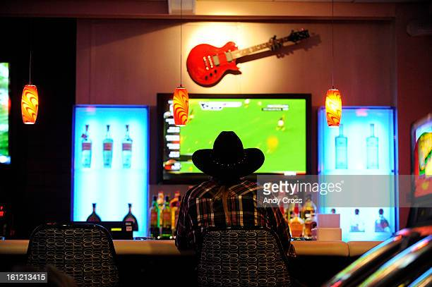 Black Hawk resident Mike Keeler plays a slot machine at the Guitar Bar at the The Reserve formally Fortune Valley Casino in Central City Thursday...
