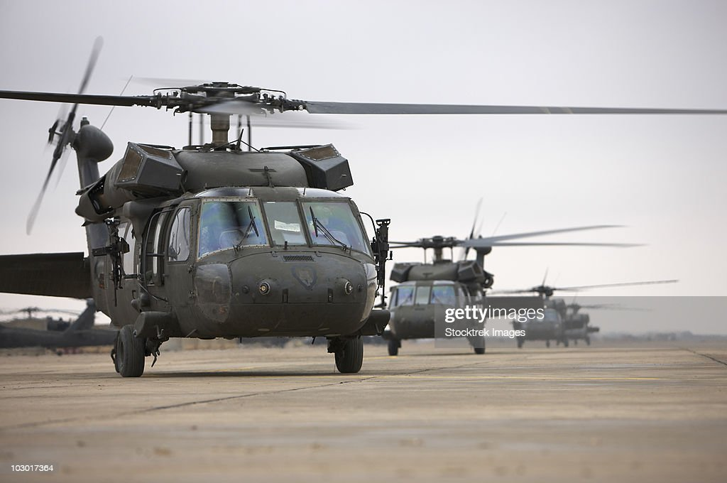 UH-60 Black Hawks taxi out for a mission over northern Iraq. : Stock Photo
