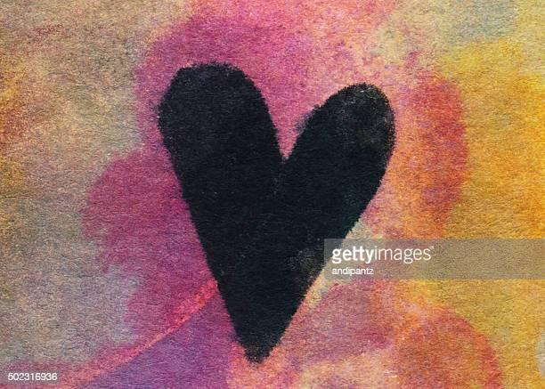 Schwarzes Herz mit der hand auf einen farbigen Hintergrund