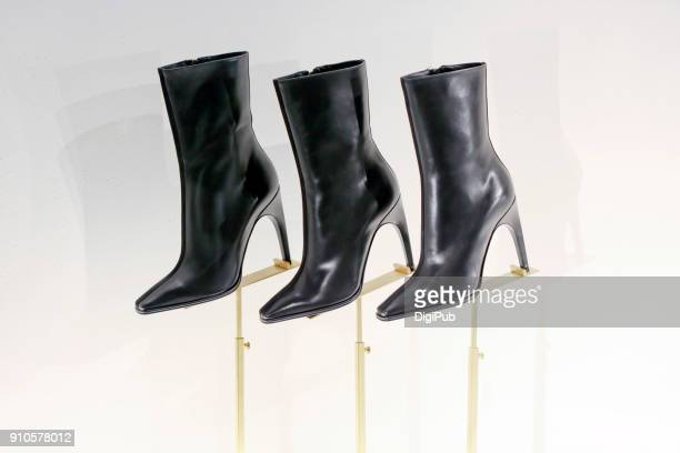 black high heel ankle boots - black boot stock pictures, royalty-free photos & images