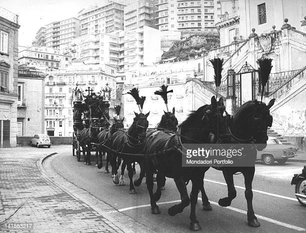 Black horses drawing Lucky Luciano's funeral carriage Naples 26th January 1962