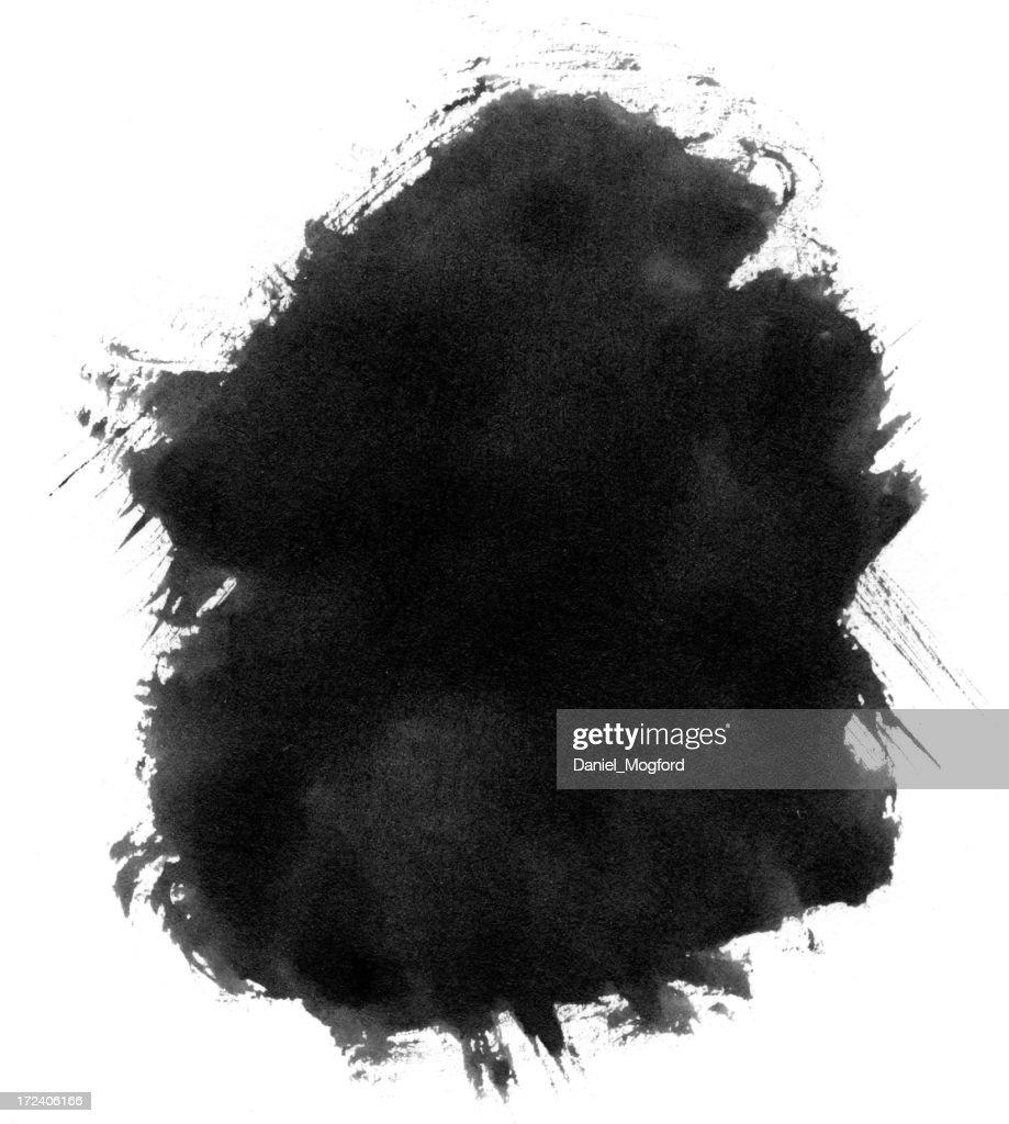 Black ink blot splattered on a white background : Stock Photo