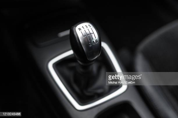black interior of a modern car, six-speed manual shift car gear lever. - gearstick stock pictures, royalty-free photos & images