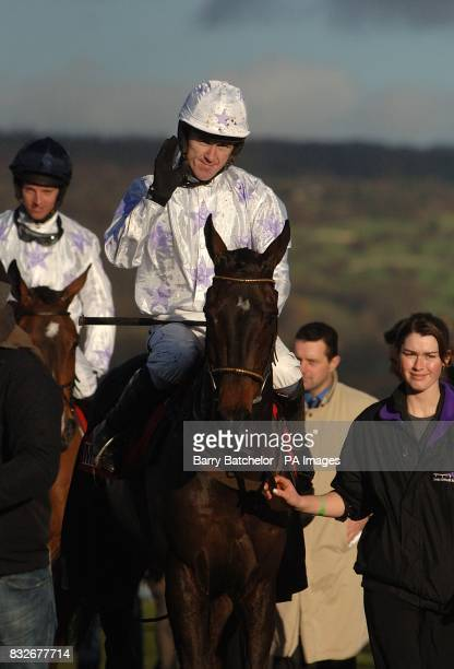 Black Jack Ketchum ridden by A P McCoy celebrates winning the Mears Group 'Relkeel' Hurdle