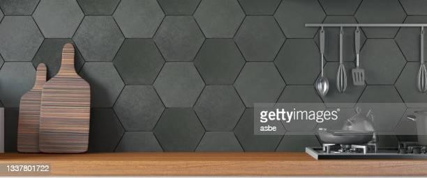 black kitchen design with counter and empty wall - front view bildbanksfoton och bilder