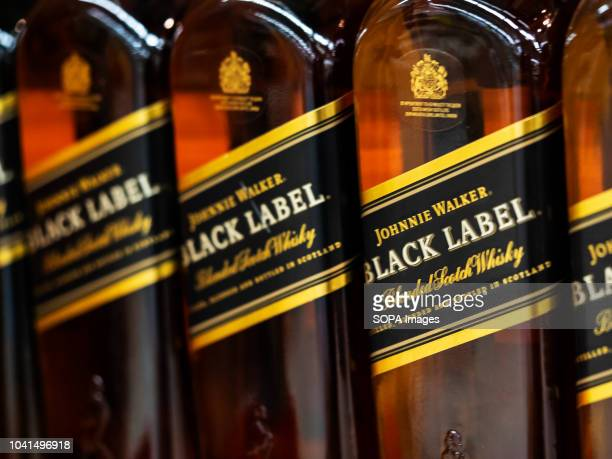 Black Label whiskey seen on the store shelf Black Label founded by Johnnie Walker in 1867