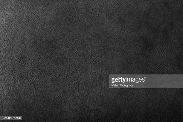 black leather and texture background. - leather stock pictures, royalty-free photos & images