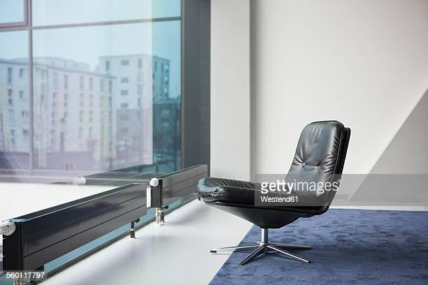 Black leather chair in a modern apartment