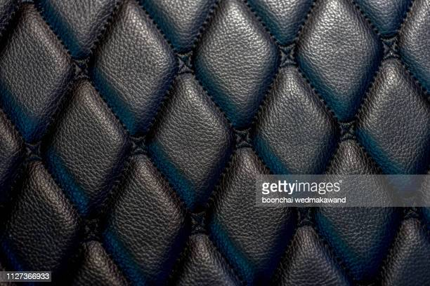 black leather floor - designer einrichtung stock-fotos und bilder