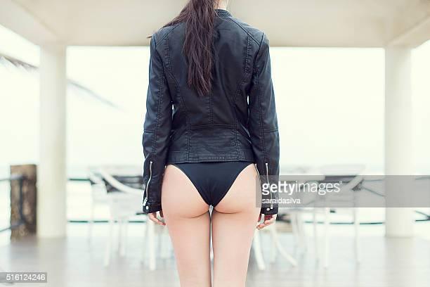 black leather jacket model - bikini bottom stock pictures, royalty-free photos & images