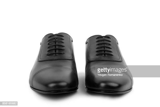 black leather male shoes, on white background - oxford shoe stock-fotos und bilder