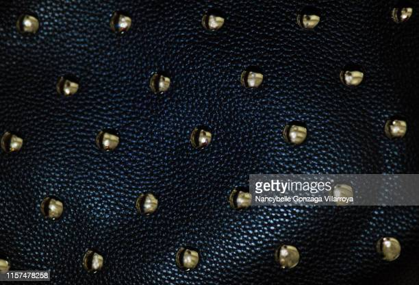 black leather material with gold studs - metallic purse stock pictures, royalty-free photos & images