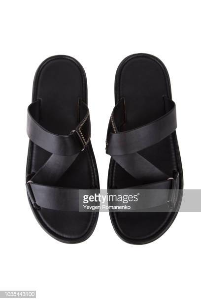 black leather mens sandals shoes isolated on white background - sandale stock-fotos und bilder