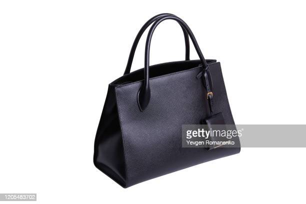 black leather women's handbag on white background - leather purse stock pictures, royalty-free photos & images