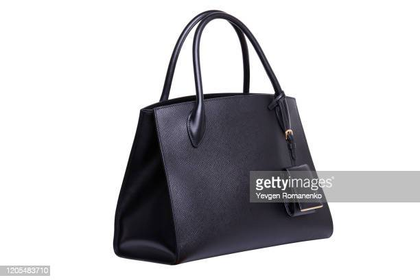 black leather women's handbag on white background - clutch bag stock pictures, royalty-free photos & images