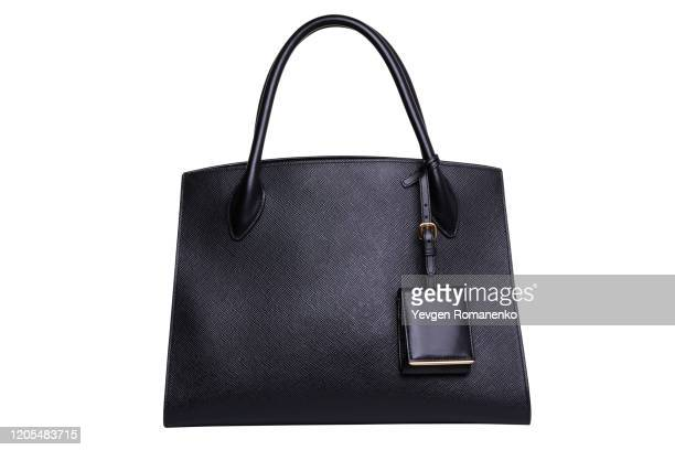 black leather women's handbag on white background - brown purse stock pictures, royalty-free photos & images