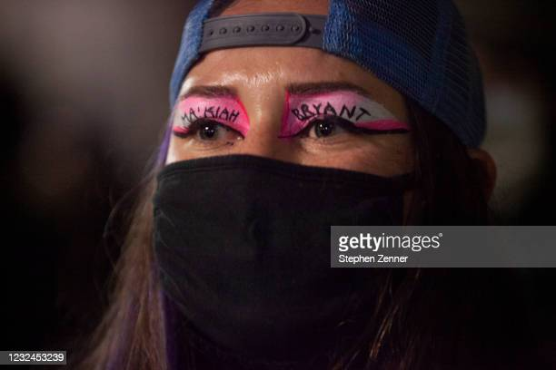 Black Lives Matter activist has their eyes painted with Makhia Bryants name during a protest in reaction to the police shooting of MaKhia Bryant on...