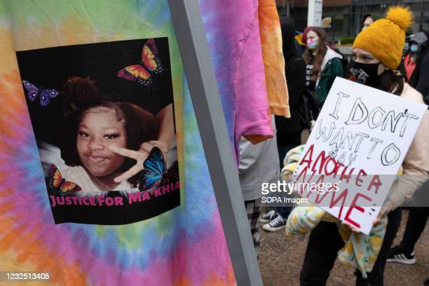 Black Lives Matter activist holds a placard during the MaKhia Bryant protest in front of the Ohio Statehouse. Black Lives Matter activists gathered...